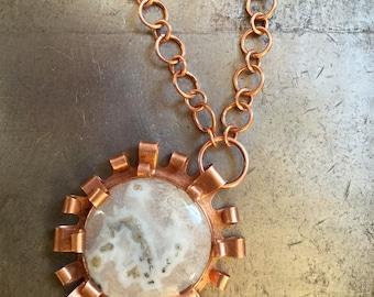 Solar quartz and copper pendant necklace on copper chain.