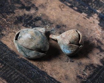 Set of 2 antique brass jingle bells, charms. Black patina of time.