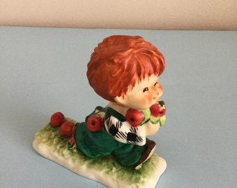 Hummel red head Forbidden Fruit figurine.