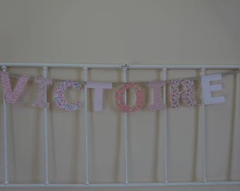 Garland fabric name 8 letters victory