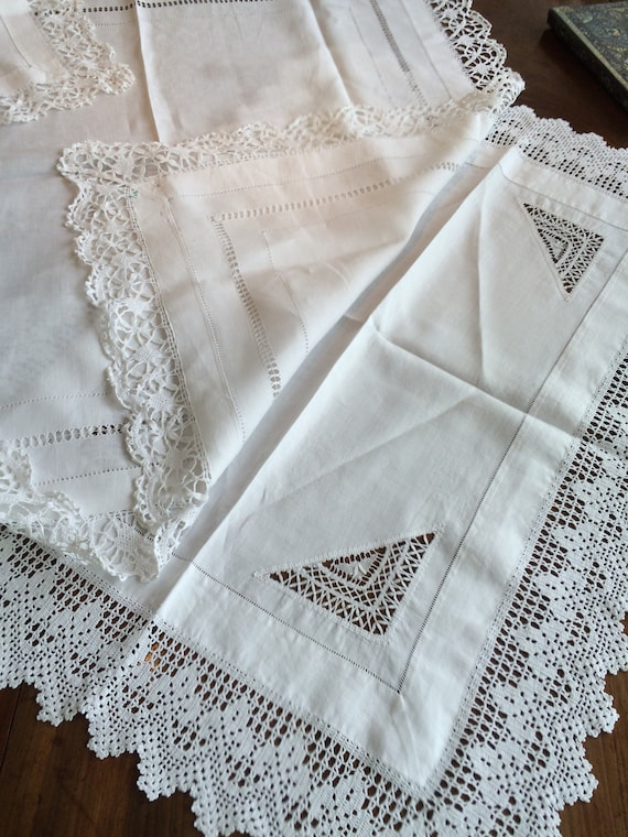 2 small pretty handworked vintage tablecloths. 32 ins square and 30x23 ins. Vintage. Strong