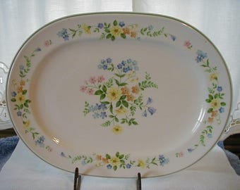 Noritake Verasatone Matchmaker pattern 9  by 13 inch meat or serving platter in perfect condition.  Lovely floral pattern.