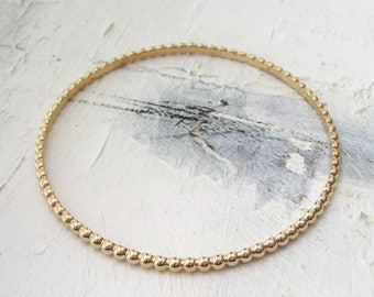 Bangle is worked in plated gold 750/1000