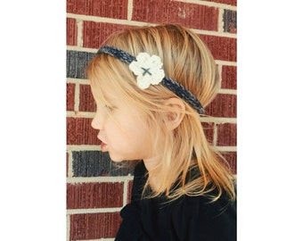 Crocheted charcoal headband with off white flower