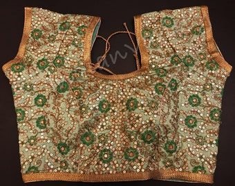 Light Green blouse with short sleeve and all over  zari sequence embroidery work