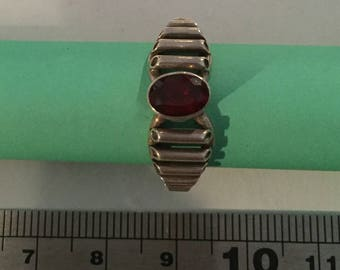 Sterling Silver Oval Garnet Facet Stone in Rubover Setting Ring