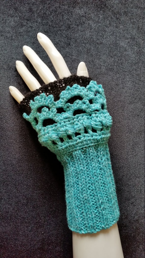 L410.  Hand knitted wristlets with crochet finish