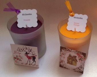 Christmas candles in frosted glass jars with festive decorations!