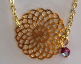 Print necklace in gold tone and Pearl Pink