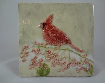 Bird tile.  Winter cardinal