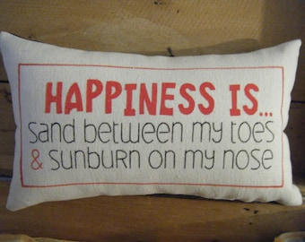 Happiness is... sand between my toes.... Pillow