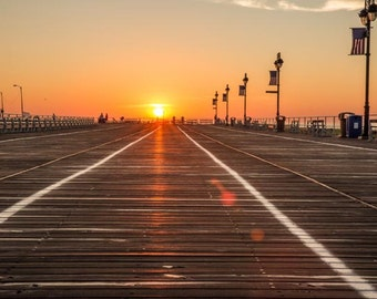 A beautiful sunrise at the end of the boardwalk.