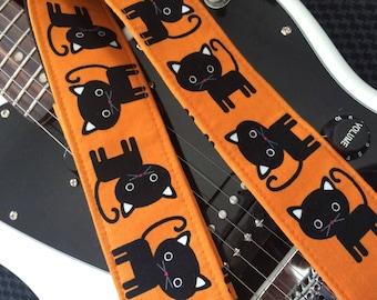 Black cat guitar strap // cool cats on orange guitar strap // rock and roll/rockabilly guitarist gift // black cat girls guitar strap