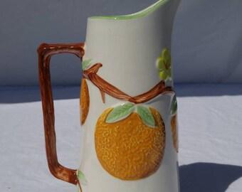Beautiful vintage mid-century National Potteries orange pitcher