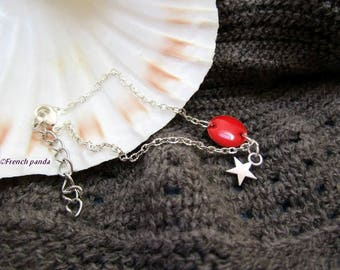 Red enameled bracelet and charm.