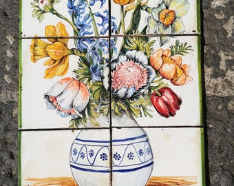 Panel of ceramic tiles depicting the flowers in the vases.