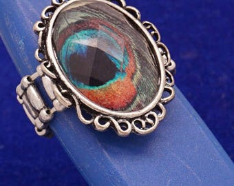Crystal ring synthetic with a Peacock eye decor, elasticated