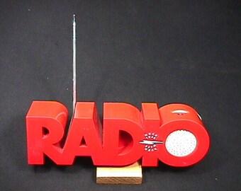 Vintage Red Plastic Transistor AM & FM Radio Reads Radio