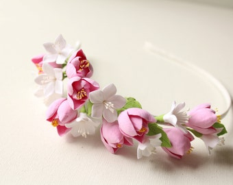 Gentle romantic image of the bride. White cherry blossom and pink freesia.Hair alice band polymer clay flower.