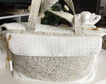 JAVA of white and gold satchel bag