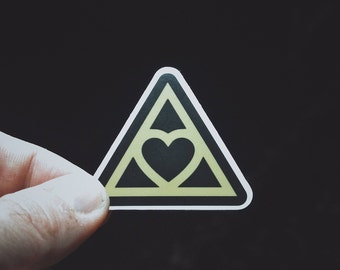 "Heart Triangle Sticker - 2"" Durable Vinyl Sticker - Illuminati Spoof - Metaphysical and Esoteric - Weather Resistant - Black and Gold"
