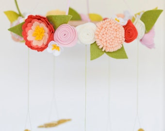 Butterflies and spring flowers baby mobile in coral, apricot, pink and cream with gold butterflies.