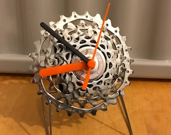 Cycle freestanding clock made from recycled bike parts.