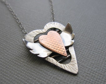 Uncaged Winged Heart Necklace Sterling Silver Copper