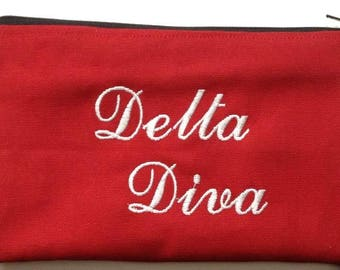Delta Diva embroidered zip pouch, cosmetic pouch