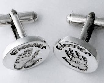 Round cufflinks personalised with hand or footprints - handmade to your design in silver.