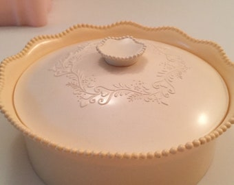 Vintage Embossed Plastic Dusting Powder Container