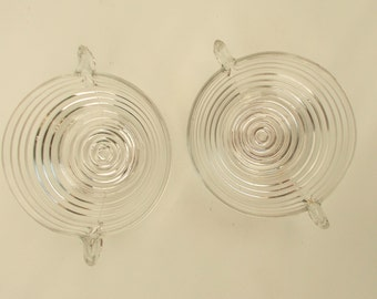 Two art deco clear glass condiment bowls