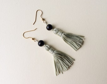 mint green tassel earrings with black and gold beads, dangle, long silk vintage tassels, edwardian art deco style, pale light green