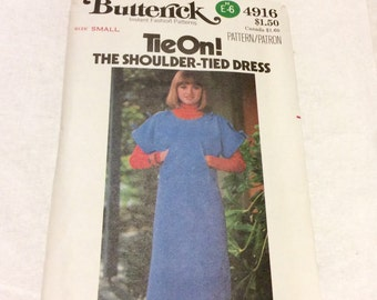 1970's Butterick sewing patterrn tie on shoulder dress size small.