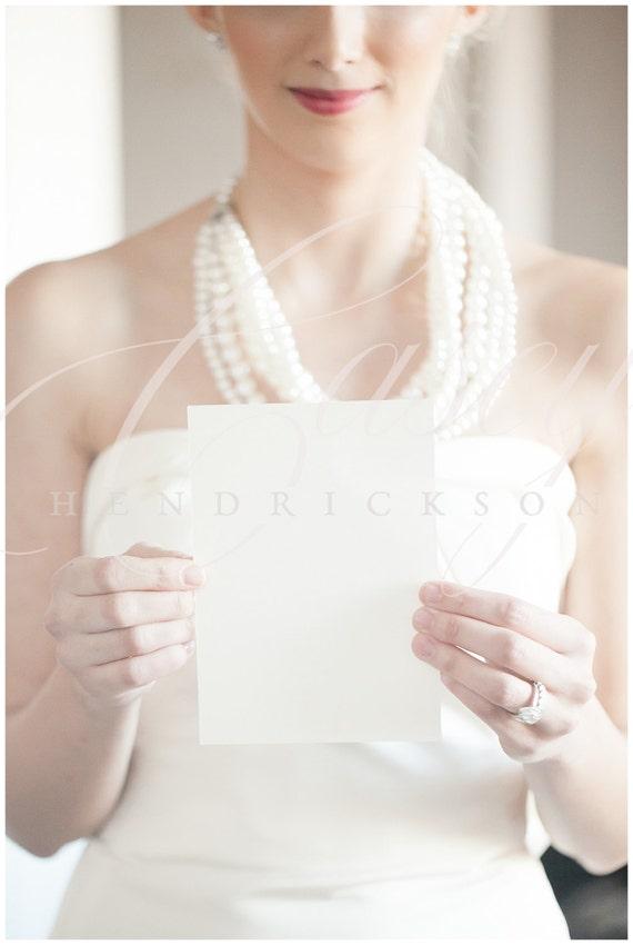 Image of bride holding 5x7 blank invitation stationery card image of bride holding 5x7 blank invitation stationery card stock photo mockup stopboris Choice Image