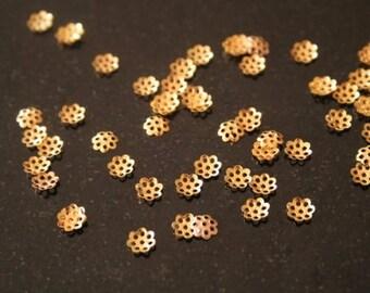 Set of 300 gold metal caps. (ref:0122).