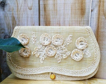 50s/60s woven floral natural straw clutch .