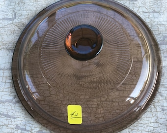 42. Small glass lid 6  3/8 inches