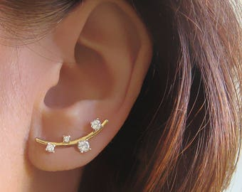 Outlines of gold plated lobes 750 18 k and CZ zirconia ear-cuff earrings