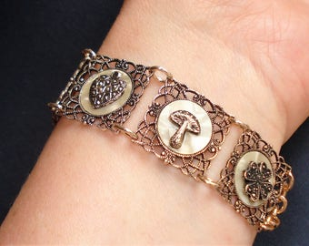 Filigree Panel Charm Bracelet Vintage Gold Tone Eloxal and Lucite Good Luck Symbols