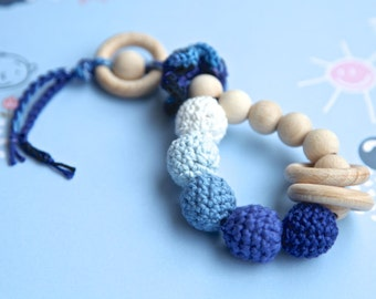 Teething toy rattle with crochet wooden beads and 3 wooden rings. Blue, dark blue, light blue, white