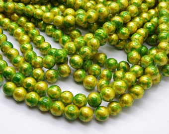 139 glass beads 6 mm painted bomb green with gold