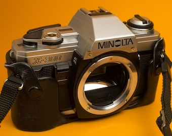 Minolta X-300 + MD 50mm f/1.7 + case and strap