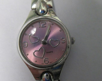 Vintage jewelry Ladies watch, silver tone with pink face with hearts used good condition