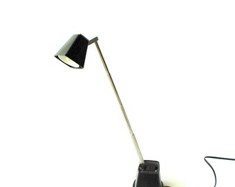 Mod vintage 60s xrom, flexible,desk,table, task lamp with a  heavy, black base and shade. Made by Vacu Lite.
