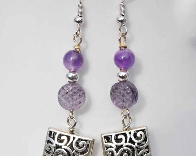 Amethyst bead earrings with intricately carved silvertone squares and fancy cut glass beads