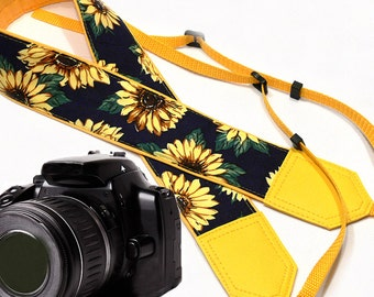 Sunflowers on dark blue camera strap. Yellow camera strap.