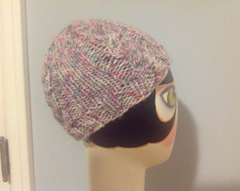 Chunky cable hat in rainbow yarn