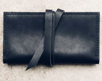 the wrap wallet in black // pure leather wallet with card + cash + phone pocket // leather wrap-around strap closure