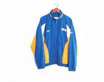 vintage windbreaker / Reebok jacket / 90s sportswear / 1990s UCLA Bruins Reebok windbreaker Large